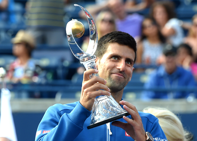 Novak Djokovic of Serbia holds up the champions trophy after defeating Kei Nishikori of Japan to win the Rogers Cup tennis tournament at Aviva Centre in Toronto, July 31, 2016.  Mandatory Credit: Dan Hamilton-USA TODAY Sports