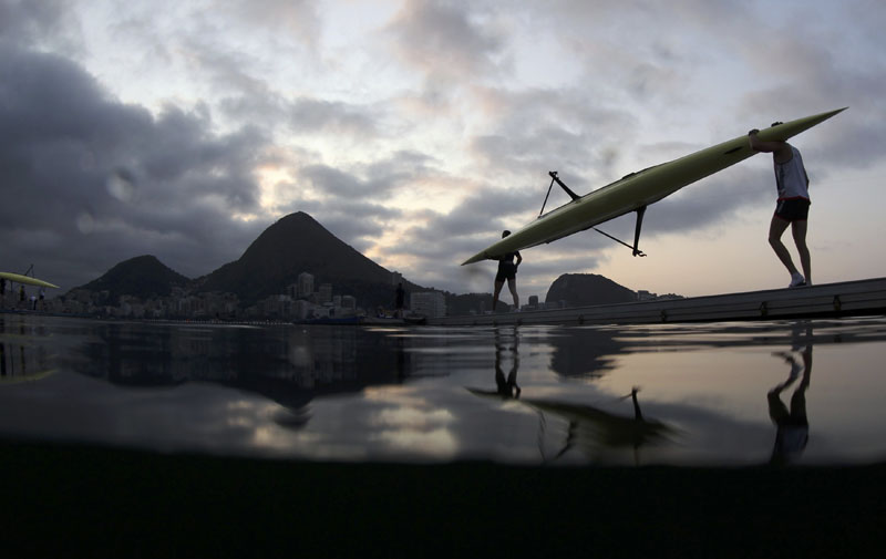 Rowers carry their boat to the water early in the morning ahead of competition during 2016 Rio Olympics, Lagoa Stadium, Rio De Janeiro, Brazil on August 9, 2016. Photo: REUTERS