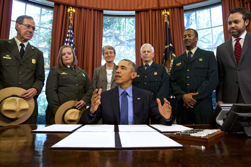 File- President Barack Obama (C) talks about the designation of three new national monuments; Berryessa Snow Mountain in California, Waco Mammoth in Texas, and the Basin and Range in Nevada, in the Oval Office of the White House in Washington, on July 10, 2015. Photo: AP