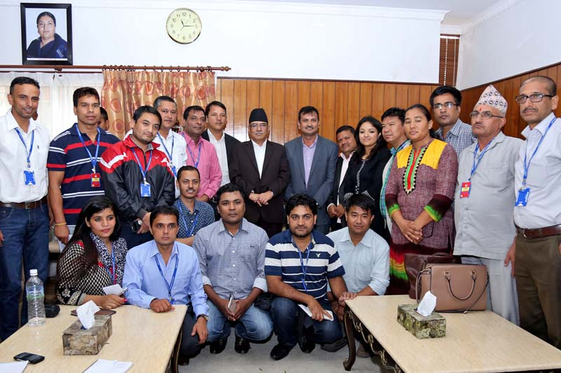 Prime Minister Pushpa Kamal Dahal poses for a photograph with officials of the Federation of Nepali Journalists at his official residence in Baluwatar, on Tuesday, August 09, 2016. Photo: RSS