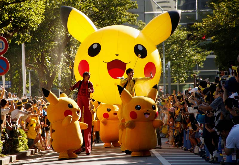 Performers wearing Pokemon's character Pikachu take part in a parade in Yokohama, Japan, on Sunday, August 7, 2016. Photo: Reuters