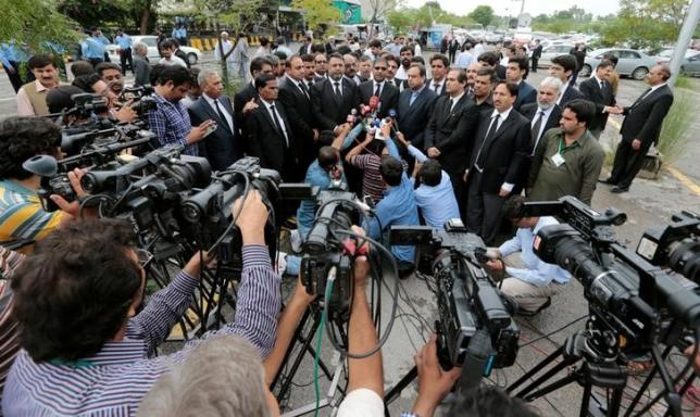 Lawyers speak with the media after protesting against the suicide bomb attack at a hospital in Quetta on Monday, outside the Supreme Court in Islamabad, Pakistan August 9, 2016. REUTERS/Caren Firouz