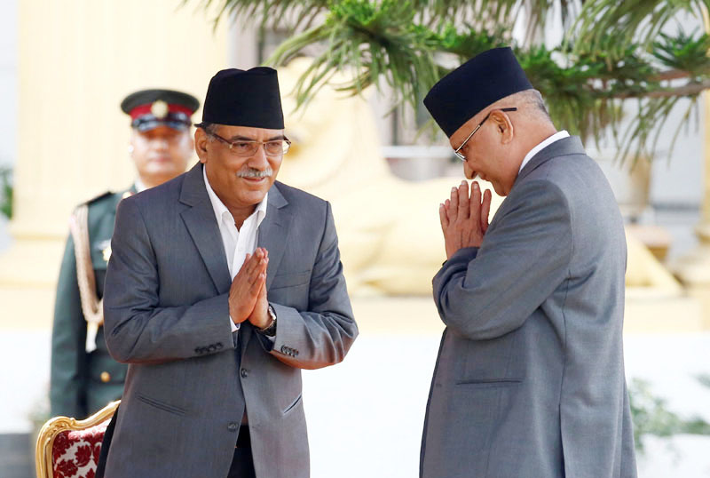 FILE: Newly elected Prime Minister Pushpa Kamal Dahal, also known as Prachanda, (left) greets outgoing Prime Minister KP Sharma Oli (right) upon their arrival during the administers of oath of office to the newly-elected Prime Minister at the Sheetal Niwas in Kathmandu, on August 4, 2016. Photo: Reuters