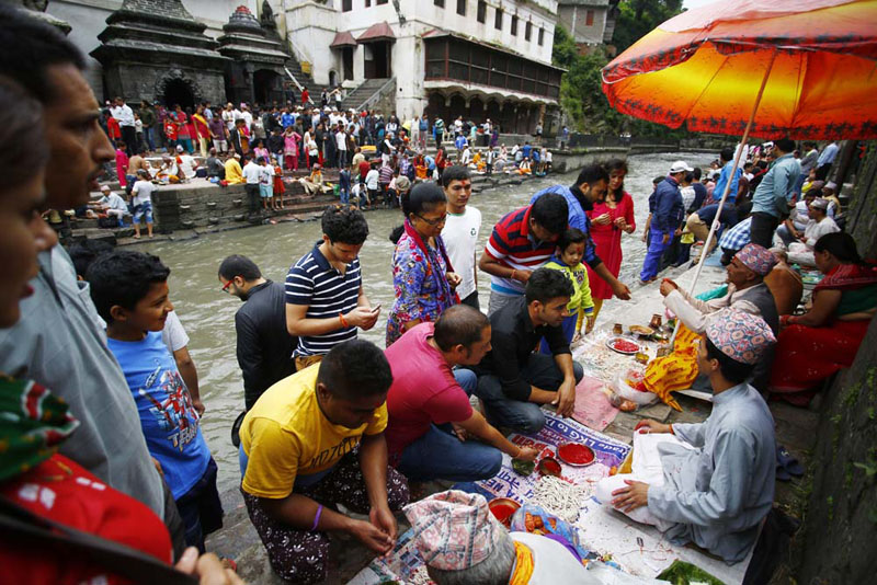 People in Pashupatinath Area gather to get Raksha Bandhan tied around their wrists on the occasion of Janai Purnima on Thursday, August 18, 2016. Photo Rajesh Gurung