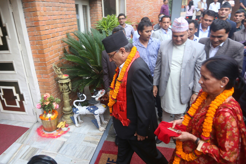 Prime Minister Pushpa Kamal Dahal and his wife Sita enter the PM's official residence in Baluwatar, on Friday, August 5, 2016. Photo: RSS