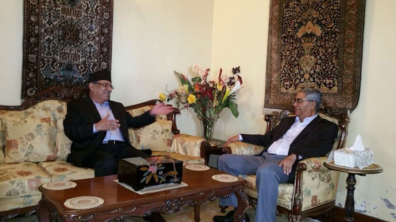 Prime Minister Pushpa Kamal Dahal and Nepali Congress President Sher Bahadur Deuba holding a meeting at the latter's residence in Budhanilkantha on Saturday, August 06, 2016. Photo Courtesy: Deuba's Twitter account