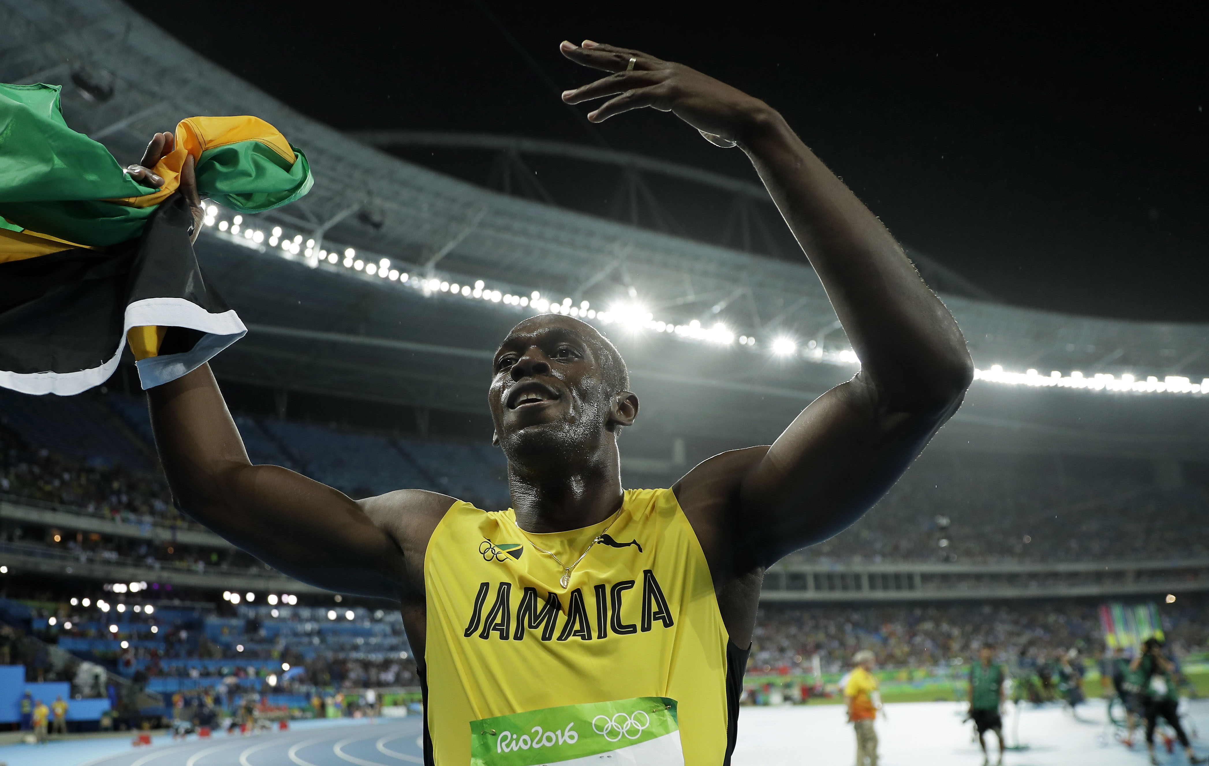 Usain Bolt from Jamaica poses for photographers with the Jamaican flag after winning the gold medal in the men's 200-meter final, during the athletics competitions of the 2016 Summer Olympics at the Olympic stadium in Rio de Janeiro, Brazil, on Thursday, August 18, 2016. Photo: AP