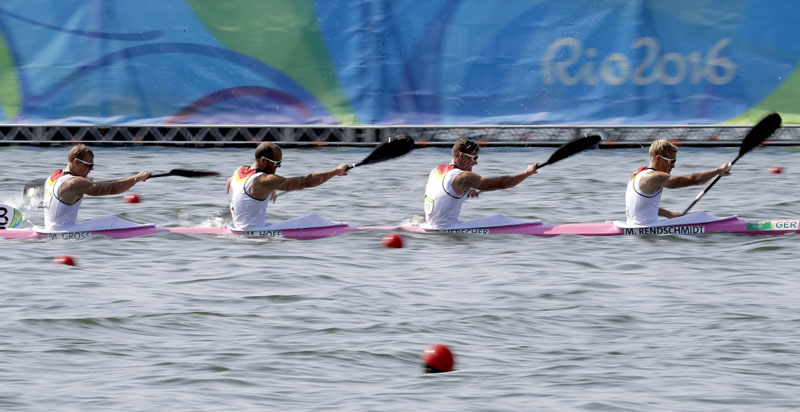 Germany's Max Rendschmidt, Tom Liebscher, Max Hoff and Marcus Gross paddle in the men's kayak four 1000m heat during the 2016 Summer Olympics in Rio de Janeiro, Brazil, Friday, Aug. 19, 2016. (AP Photo/Andre Penner)