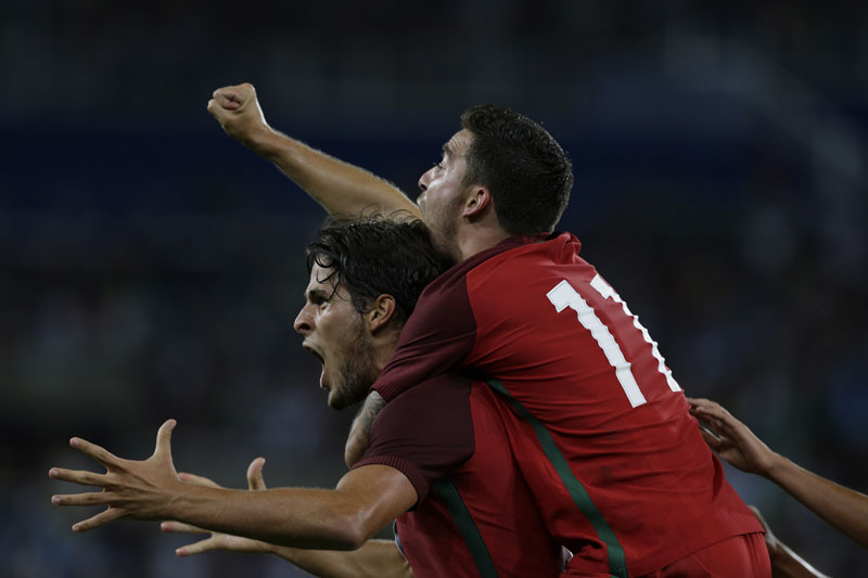 Portugal's Paciencia (bottom) celebrates scoring his side's first goal with his teammate Salvador Agra during a group D match of the men's Olympic football tournament between Portugal and Argentina at the Rio Olympic Stadium in Rio De Janeiro, Brazil, on Thursday, August 4, 2016. Portugal won 2-0. Photo: AP