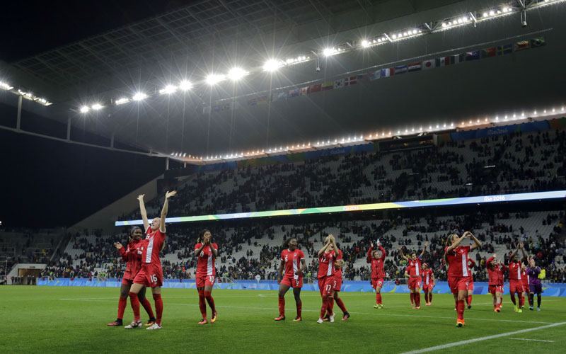 Canada's Janine Beckie (second from left) greets supporters as her and teammates celebrate after beating France in a quarter-final match of the women's Olympic football tournament between Canada and France in Sao Paulo, Brazil, on Friday August 12, 2016. Canada's won1-0 and went through to the semi-finals.Photo: AP