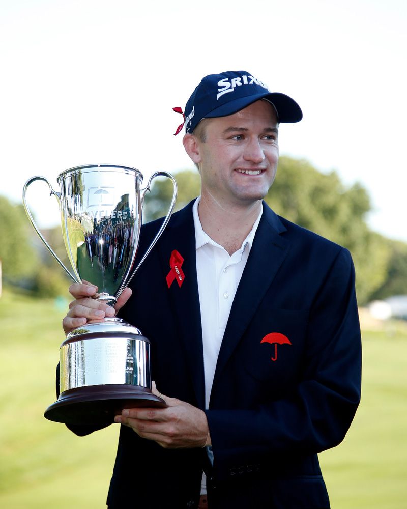 Russell Knox of Scotland poses with the trophy after winning the Travelers Championship at TCP River Highlands on August 7, 2016 in Cromwell, Connecticut. Photo: AFP