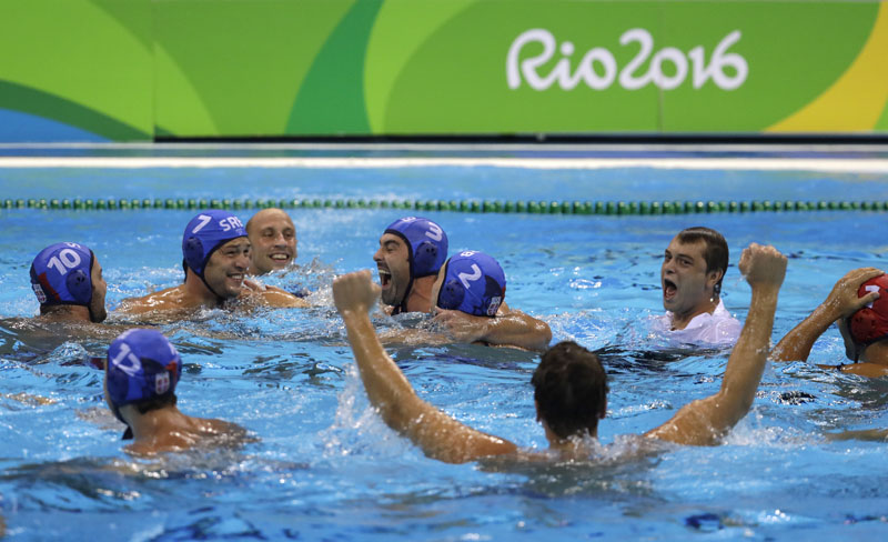 Members of the Serbia men's water polo team celebrate after winning the gold medal match against Croatia at the 2016 Summer Olympics in Rio de Janeiro, Brazil, on Saturday, August 20, 2016. Photo: AP