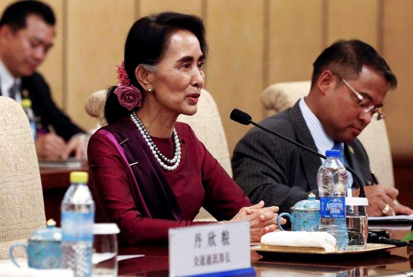 Myanmar State Counsellor Aung San Suu Kyi (left) speaks during a meeting with Chinese Premier Xi Jinping (not in photo) at the Diaoyutai State Guesthouse in Beijing, China, August 19, 2016. REUTERS/Rolex Dela Pena/Pool