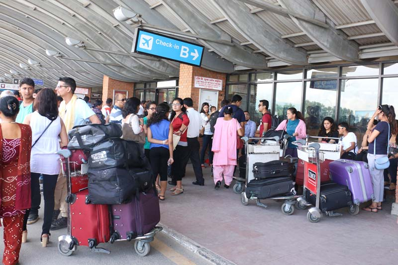 A crowd of Nepali students gathered at the Tribhuvan International Aiirport (TIA) before departing to China for further studies in Kathmandu, on Monday, August 15, 2016. Photo: RSS