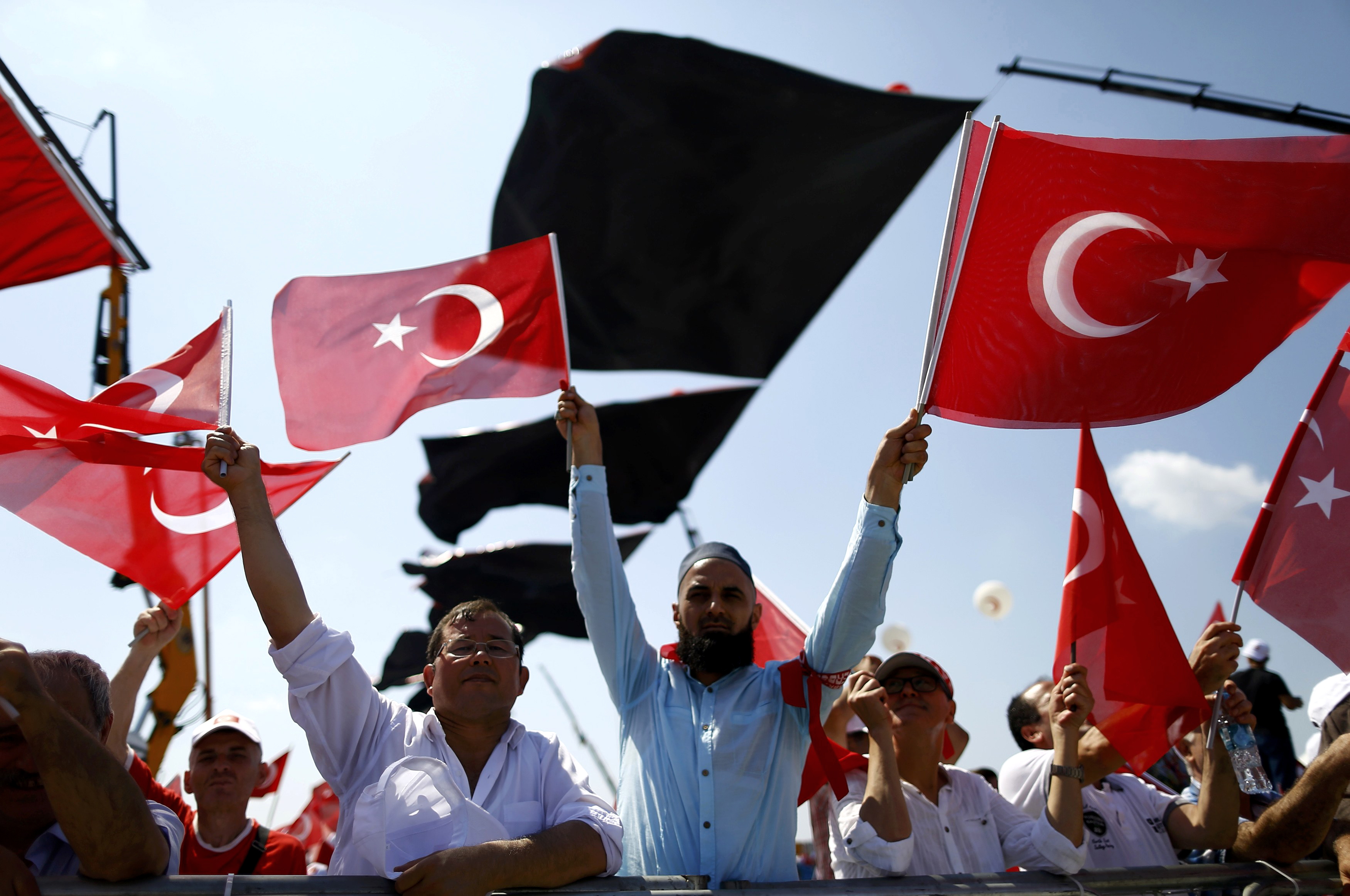 People wave Turkey's national flags ahead of the Democracy and Martyrs Rally, organised by Turkish President Tayyip Erdogan and supported by ruling AK Party (AKP), oppositions Republican People's Party (CHP) and Nationalist Movement Party (MHP), to protest against last month's failed military coup attempt, in Istanbul, Turkey, August 7, 2016. Photo: Reuters