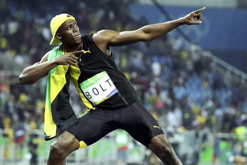 Usain Bolt of Jamaica with his signature pose after winning the gold medal in Men's 100m Final at the Olympic Stadium in Rio de Janeiro, Brazil, on Sunday, August 14, 2016. Photo: Reuters