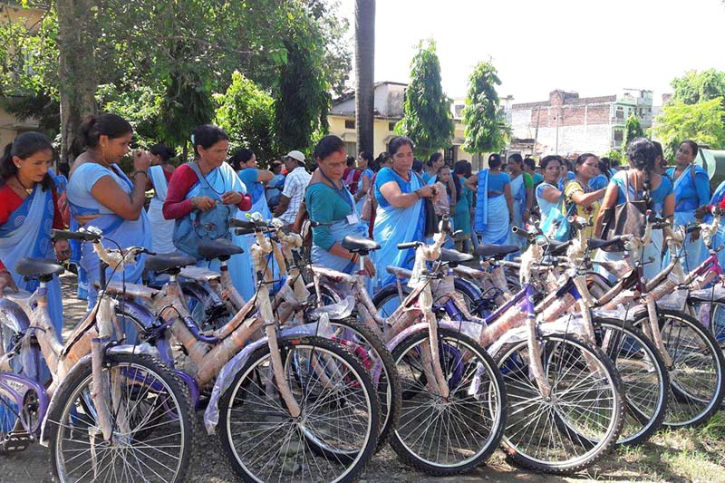 Women volunteers get ready to ride bicycles provided by the Municipality Office for their daily use, in Kanchanpur district, on Tuesday, August 02, 2016. Photo: RSS.