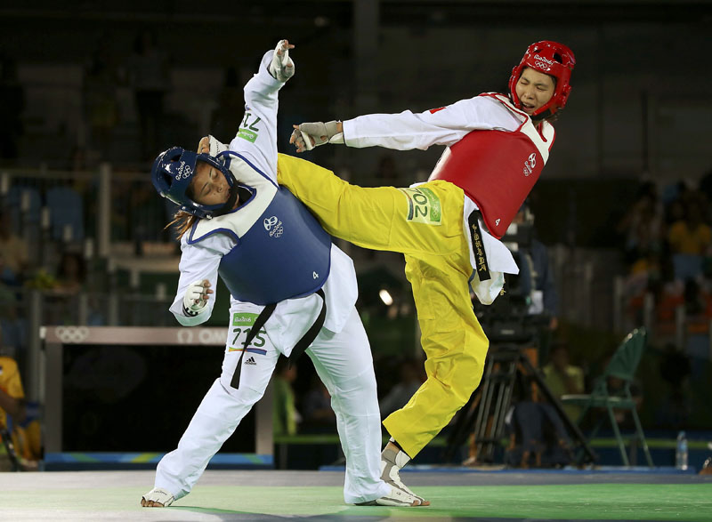 Taekwondo player Nisha Rawal (NEP) of Nepal competes with Zheng Shuyin (CHN) of China during the women's Taekwondo +67kg Preliminary round at Carioca Arena 3 in Rio de Janeiro, Brazil, on Saturday, August 20, 2016. Photo: Reuters