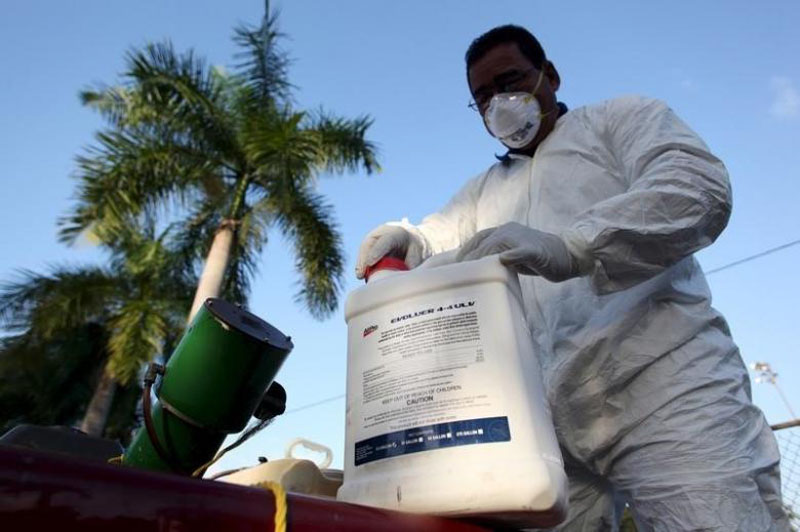 File - A health worker prepares insecticide before fumigating a neighborhood in San Juan, Puerto Rico, on January 27, 2016. Photo: Reuters