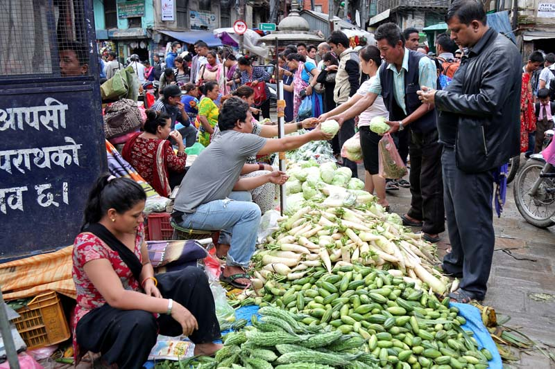 Customers buy fresh vegetables from the street vendors at Ason, in Kathmandu, on Tuesday, August 2, 2016. Photo: RSS