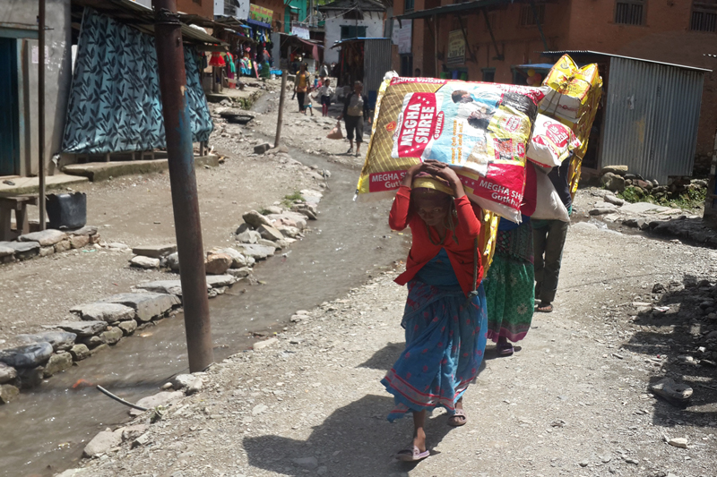 FILE: Locals of Dolpa heading toward their home from Bagara of Jajarkot carrying daily consumables on their back, on Wednesday, August 17, 2016. These people say their hope is four-day walk from Bagara. Photo: RSS