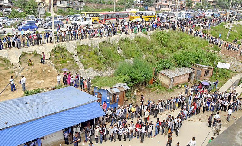 Families of earthquake victims queuing at the office of the Department of Transport Management to submit registraion forms permitting them to import cars and start cab service, in Ekantakuna, Lalitpur, on Wednesday, August 10, 2016. Photo: THT