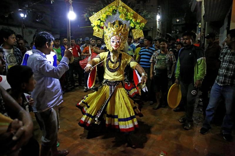 An artist, clad as a deity, performing traditional the Mahakali dance in Nagadesh, Bhaktapur, Nepal on Sunday, August 21, 2016. Photo: Skanda Gautam/THT