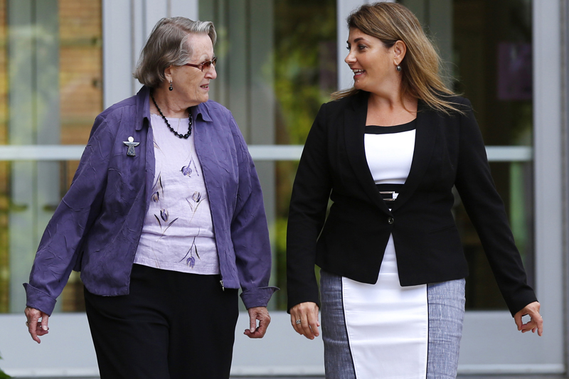In this August 11, 2016 photo, Angela McArthur, right, director of the Anatomy Bequest Program at the University of Minnesota Medical School, walks with Jean Larson, widow of a donor in Minneapolis. Once a relatively rare option, body donation has surged at medical schools, including the University of Minnesota. Photo: AP
