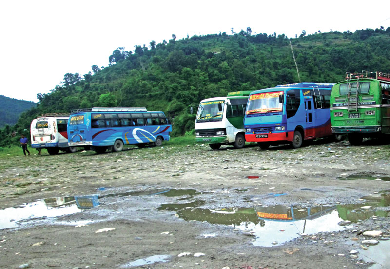 Passenger buses parked haphazardly in Bhimad bus park, Tanahun, on Friday.