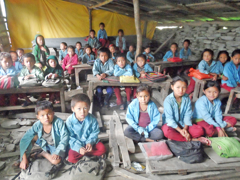 Local kids are compelled to sit on the floor in a makeshift classroom in Manpu-9 of Gorkha district, on Monday, August 15. 2016. Delay in reconstruction of the school buildings damaged by last year's devastating earthquake had added misery to the students. Photo: RSS