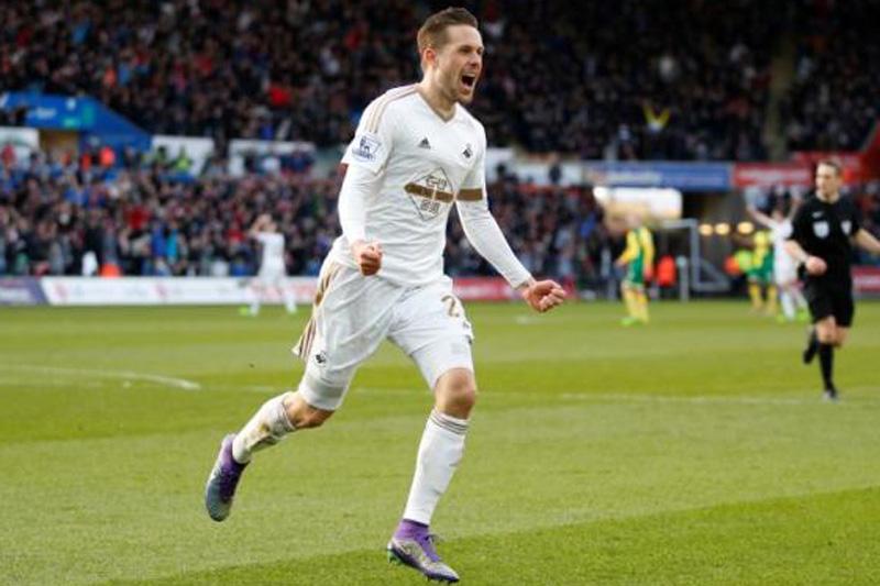 Swansea's Gylfi Sigurdsson celebrates scoring their first goal. Mandatory Credit: Action Images / Peter Cziborra