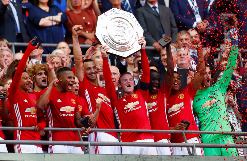 Manchester United's Wayne Rooney celebrates with the trophy after winning the FA Community Shield. Photo: Reuters
