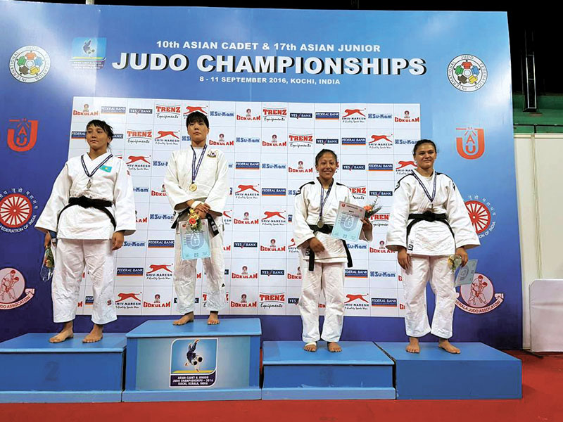 Nepali Judoka Phupu Lhamu Khatri (second from right) poses for a photo on the podium after winning bronze medal at the 17th Asian Junior Judo Championship at the Rajiv Gandhi Indoor Stadium in Kerala, India on Sunday, September 11, 2016. Photo: THT