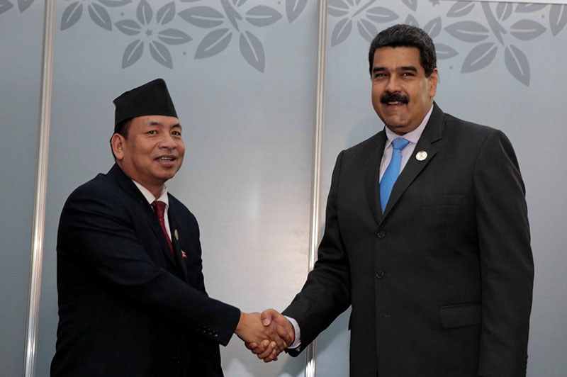 Venezuela's President Nicolas Maduro (right) attends a private meeting with Vice President Nanda Bahadur Pun, during the 17th Non-Aligned Summit in Porlamar, Venezuela, on September 18, 2016. Photo: Miraflores Palace via Reuters