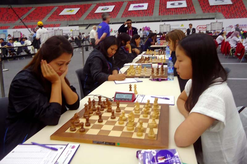 Nepal's Sindira Joshi ponders her move against FIDE Master Qiyu Zhou of Canada during their first-round match of the 42nd Chess Olympiad in Baku, Azerbaijan on Friday, September 2, 2016. Photo Courtesy: Nepal Chess Association