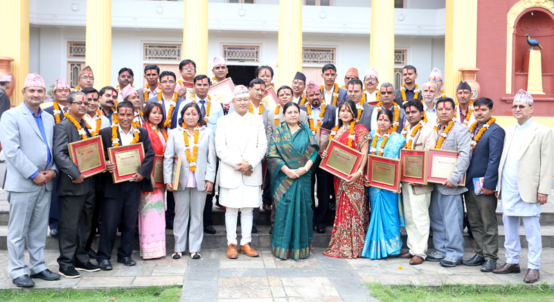 Awardees, along with President Bidya Devi Bhandari and other officials of Press Council Nepal, pose for a photograph at a programme organised to celebrate the 47th Anniversary of PCN in the President's office, in Kathmandu, on Thursday, September 22, 2016. Photo: RSS