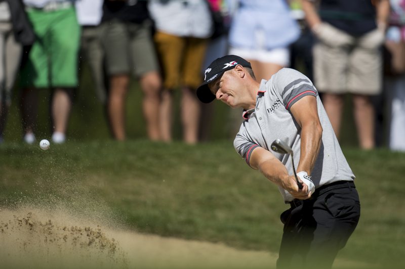 Alex Noren of Sweden hits out of a bunker  during the third round of the Omega European Masters Golf Tournament in Crans-Montana, Switzerland, Saturday, September 3, 2016. Photo: AP