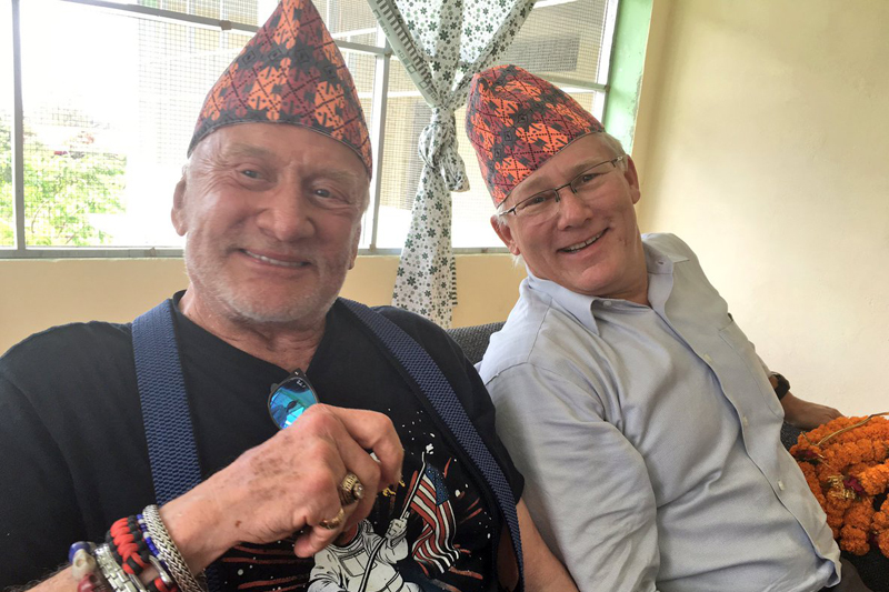 American astronaut Buzz Aldrin (right) and his son Andy pose for a photograph in Nepali topis in Kathmandu, on Thursday, September 9, 2016. Photo: Buzz Aldrin/Twitter