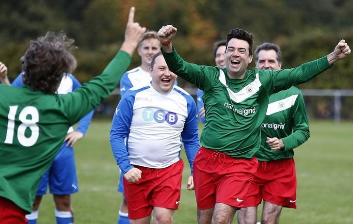 Britain's shadow home secretary, Andy Burnham (R), celebrates winning the annual Labour Party versus Journalists soccer match, on the first day of the Labour Party conference, in Liverpool, Britain September 25, 2016.  REUTERS/Peter Nicholls