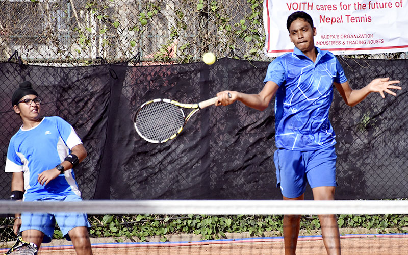 Indiau2019s Arnav Pathange, who teamed up with Amitoj Singh Sachedeva, returns to Saharsh Chand and Aadit Subedi of Nepal during the boysu2019 doubles final of Kesha Group-ANLTA Junior Ranking Tour U-14 Circuit-I Tournament in Lalitpur on Tuesday, September 6, 2016. Photo: Naresh Shrestha/THT