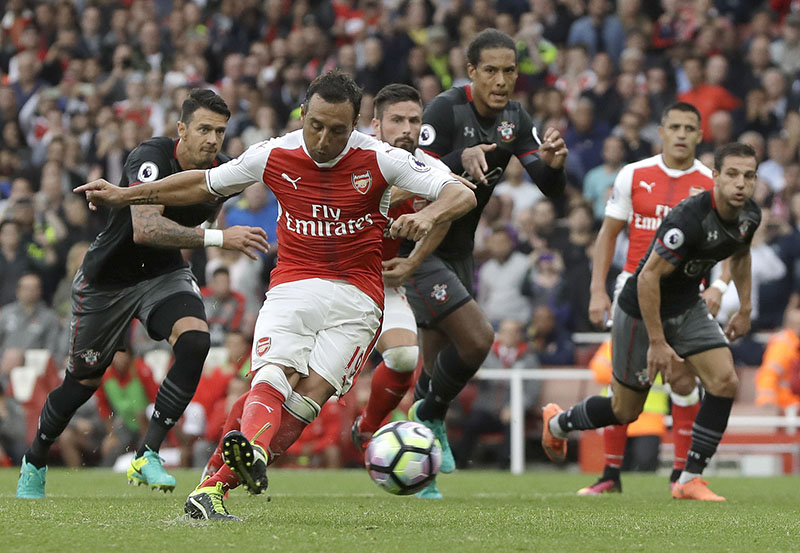 Arsenal's Santi Cazorla scores against Southampton during the English Premier League soccer match between Arsenal and Southampton at Emirates stadium in London, on Saturday, September 10, 2016. Photo: AP