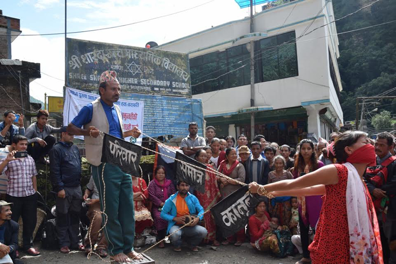 Artists perform in a play in Sindhupalchok. Photo Courtesy: OXFAM