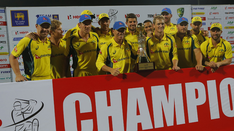 Members of the Australian cricket team pose with the series trophy after defeating Sri Lanka in the fifth and final one-day international in Pallekele, Sri Lanka, Sunday, Sept. 4, 2016. Australia won the series 4-1. Photo: AP