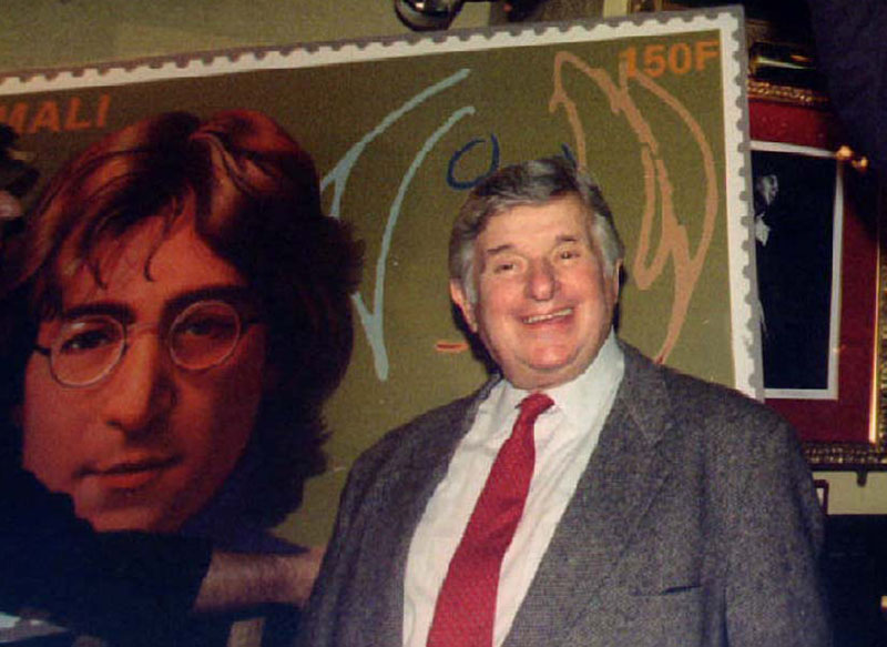 File- Former Beatles' promoter Sid Bernstein stands with new stamps at a John Lennon World Postal Tribute in New York, New York, December 8, 1995. Photo: REUTERS