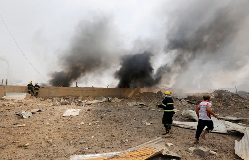 Firemen inspect the site of a blast caused by a fire at a weapons storage in eastern Baghdad, Iraq, on September 2, 2016. Photo: Reuters