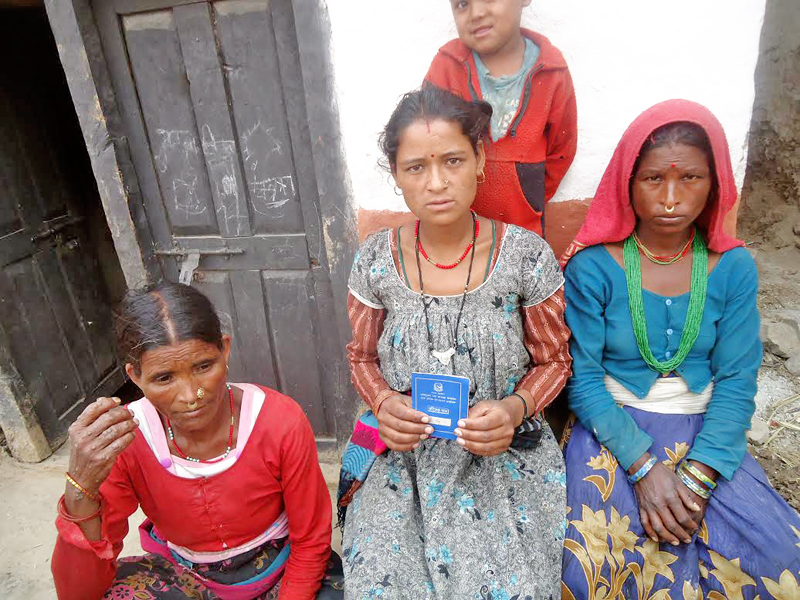A freed Haliya woman showing her identity card at Bandhu VDC, in Bajura, on Tuesday, September 6, 2016. Photo: THT