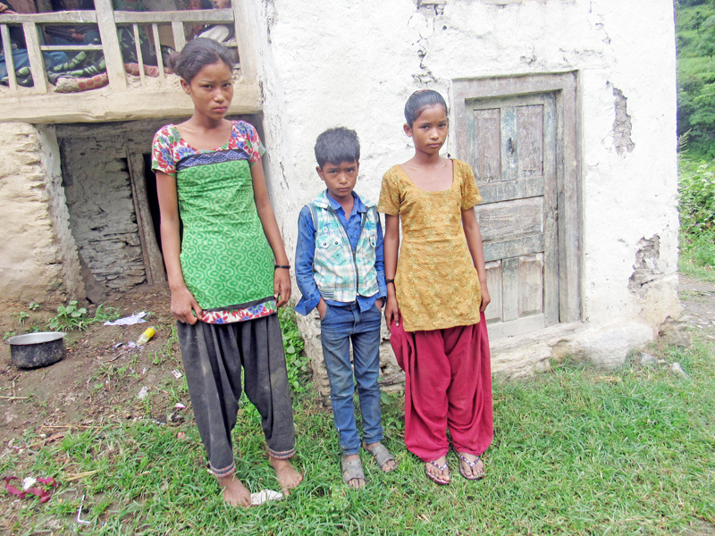 Children abandoned by their mother standing outside their home in Kolti VDC, Bajura, on Friday, September 2, 2016. Photo: THT