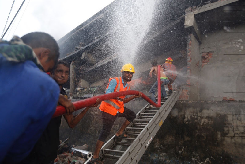 Firefighters work to put out a fire at a packaging factory in Tongi industry area outside Dhaka, Bangladesh on Saturday, September 10, 2016. Photo: AP