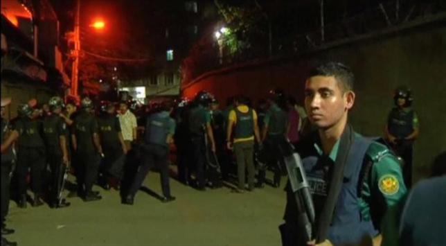 Members of the rapid action police battalion stand outside a house where suspected militants lived in Dhaka, Bangladesh September 10, 2016 in this still image taken from video. REUTERS/via Reuters TV