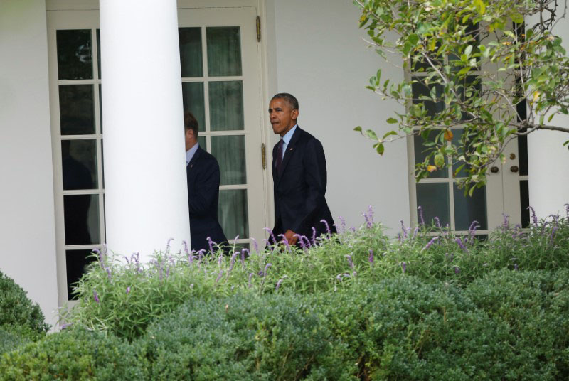 US President Barack Obama walks to the the Oval Office of the White House upon his return to Washington from New York, US, on September 21, 2016. Photo: Reuters